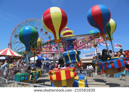 BROOKLYN, NY- JUNE 15: Kids ride at Coney Island Luna Park on June 15, 2014. Coney Island Luna Park was destroyed by fire in 1944, then reopened in 2010 - stock photo