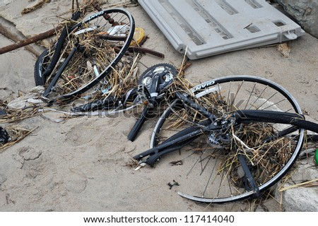 BROOKLYN, NY - NOVEMBER 01: Abandon bicycle at Seagate beach due to impact from Hurricane Sandy in Brooklyn, New York, U.S., on Thursday, November 01, 2012. - stock photo