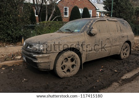BROOKLYN, NY - NOVEMBER 01: Serious damage and dirt on the cars at the Seagate neighborhood due to impact from Hurricane Sandy in Brooklyn, New York, U.S., on Thursday, November 01, 2012. - stock photo
