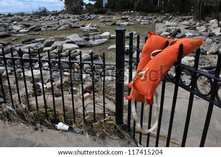 BROOKLYN, NY - NOVEMBER 01: Somebody's life jacket at the fence at the Manhattan beach neighborhood due to impact from Hurricane Sandy in Brooklyn, New York, U.S., on Thursday, November 01, 2012. - stock photo