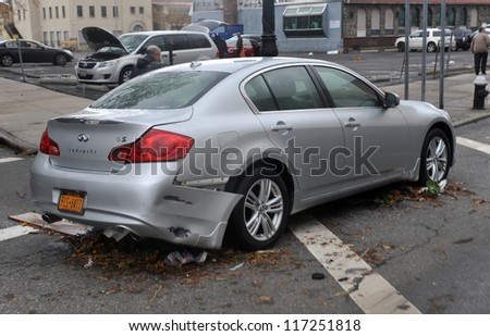 BROOKLYN, NY - OCTOBER 30: Damaged and abandoned car in the Sheapsheadbay neighborhood due to flooding from Hurricane Sandy in Brooklyn, New York, U.S., on Tuesday, October 30, 2012. - stock photo