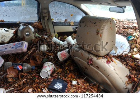 BROOKLYN, NY - OCTOBER 30: Debris litters inside abondoned cars in the Sheapsheadbay neighborhood due to flooding from Hurricane Sandy in Brooklyn, New York, U.S., on Tuesday, October 30, 2012. - stock photo