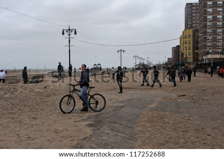 BROOKLYN, NY - OCTOBER 30: Debris litters the ground in the Brighton beach due to flooding from Hurricane Sandy in Brooklyn, New York, U.S., on Tuesday, October 30, 2012. - stock photo