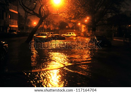 BROOKLYN, NY - OCTOBER 29: Flooded street, caused by Hurricane Sandy, are seen on October 29, 2012, in the corner of Bragg street and  Shore Pway of Brooklyn NY, United States. - stock photo