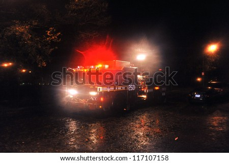 BROOKLYN, NY - OCTOBER 29: Flooded street with fire truck, caused by Hurricane Sandy, are seen on October 29, 2012, in the corner of Brigham street and  Emmons Avenue of Brooklyn NY, United States. - stock photo