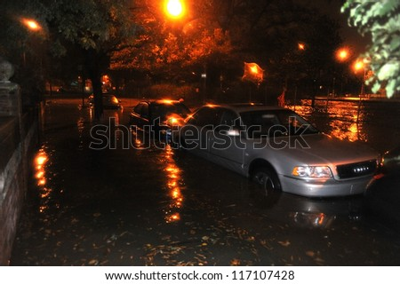 BROOKLYN, NY - OCTOBER 29: Flooded streets, caused by Hurricane Sandy, are seen on October 29, 2012, in the corner of Brigham street and  Shore Pway of Brooklyn NY, United States. - stock photo