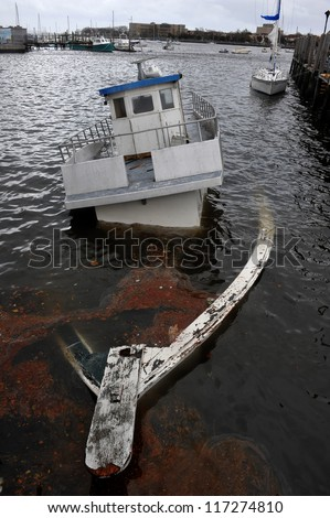 BROOKLYN, NY - OCTOBER 30: Sunken boat in the Sheapsheadbay channel due to impact from Hurricane Sandy in Brooklyn, New York, U.S., on Tuesday, October 30, 2012. - stock photo