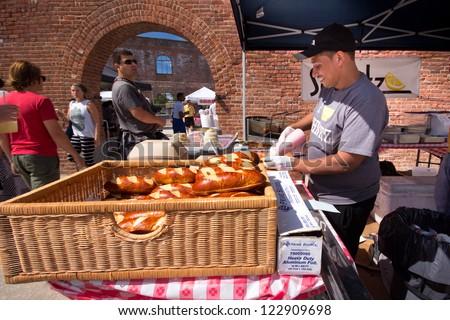 BROOKLYN, NY - SEPT 16:  Food vendor at Brooklyn Flea Market Smorgasburg in DUMBO Brooklyn on Sept 16, 2012. This food market attraction runs in historic tobacco warehouse under the Brooklyn Bridge - stock photo