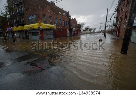 BROOKLYN, NY/USA - OCTOBER 30: Floodwaters from hurricane Sandy remain on the streets on October 30, 2012 in the Coney Island section of Brooklyn. - stock photo
