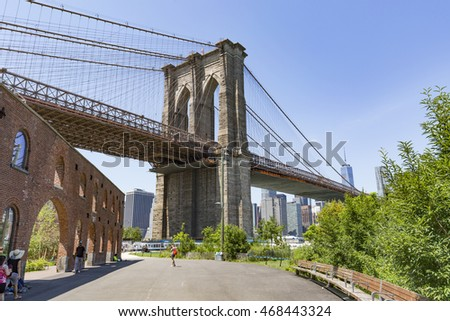 BROOKLYN, NYC - July 20: Brooklyn Bridge from Brooklyn Bridge Park, DUMBO, NYC seen on July 20, 2016. The park on the East River offers magnificent view of historic, landmark Brooklyn Bridge.
