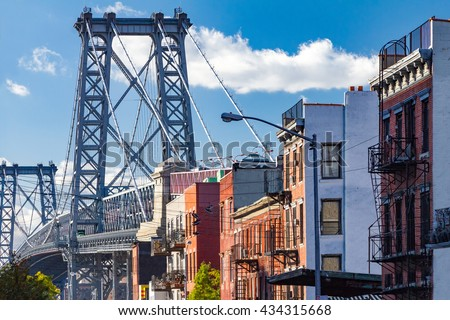 Brooklyn street scene with block of buildings near the Williamsburg Bridge in New York City - stock photo