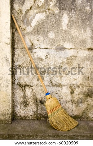 broom against a rough wall - stock photo