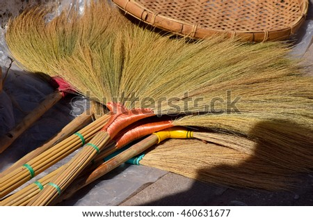 broom for clean the house, traditional , weave from grass flowers in native market in the morning, Nampad, Uttaradit, Nortern of Thailand