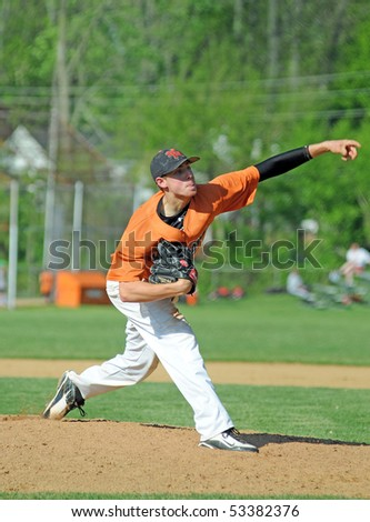 BROOMALL, PA - APRIL 30: Marple Newtown High School pitcher Chris Kirsch, projected to be a 2010 draft pick, delivers a pitch on April 30, 2010 in Broomall, PA. - stock photo