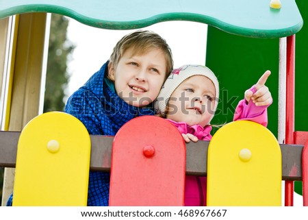 brother and little sister on the playground