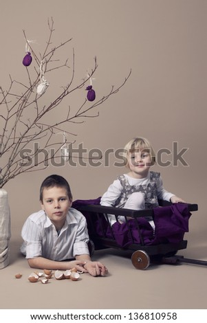 Brother and sister during Easter - stock photo
