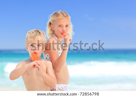 Brother and sister eating an ice cream - stock photo