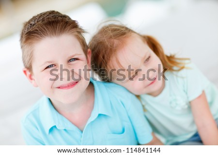 Brother and sister embracing each other - stock photo