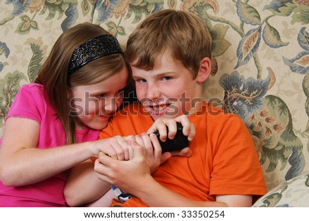 Brother and sister fighting over the TV remote control