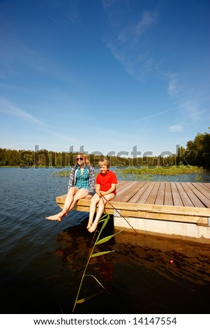 Brother and Sister fishing - stock photo