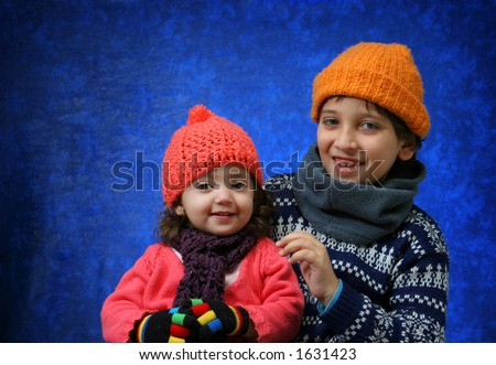 Brother and sister having fun in winter outfit. Look at my gallery for more winter images