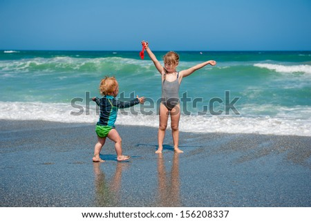 Brother and sister having fun on beach vacation