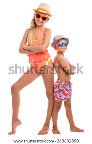 Brother and sister in a swimsuit bright color. Isolated. - stock photo