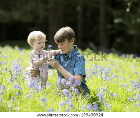 Brother and Sister in bluebell field