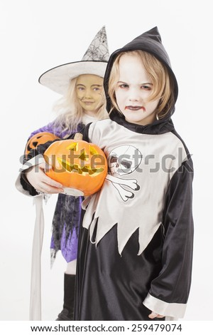 Brother and sister in halloween costume with lantern, portrait - stock photo