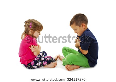 Brother and sister in quarrel. Isolated on a white background  - stock photo