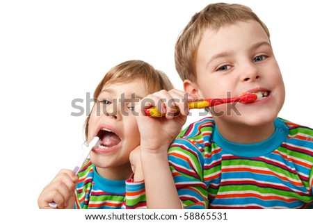 Brother and sister in same shirts brush their teeth on white background. Close-up. Isolated. - stock photo