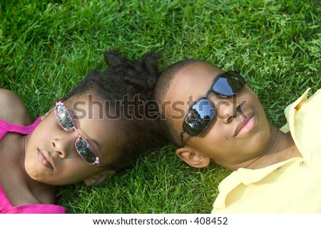 Brother and sister in sun glasses - stock photo