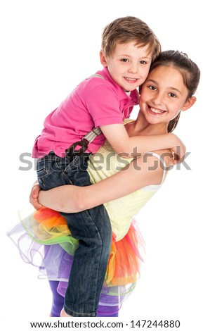 Brother and sister isolated on white studio background. Young girl is lifting up her brother. Both are smiling and looking happy. - stock photo