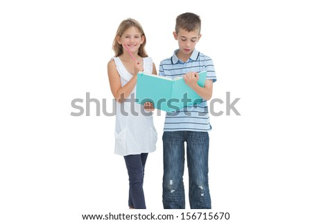 Brother and sister learning their lesson together while posing on white background - stock photo