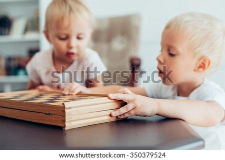 Brother and sister like to play chess at home