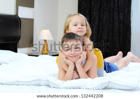 brother and sister on the bed