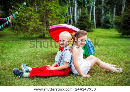 brother and sister outdoors in the summer park - stock photo