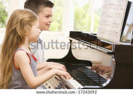 Brother And Sister Playing Piano - stock photo