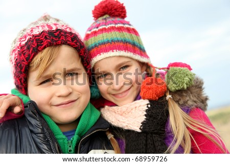 Brother and sister portrait in winter time - stock photo