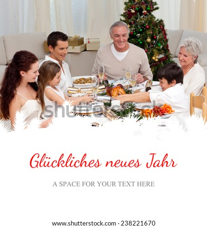 Brother and sister pulling a Christmas cracker at home against christmas greeting in german - stock photo