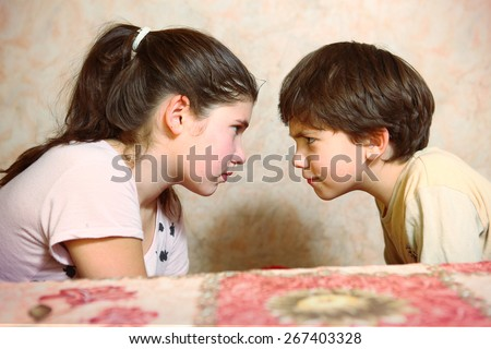 brother and sister quarreling - stock photo
