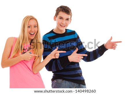 Brother and sister shows on something with their fingers - stock photo