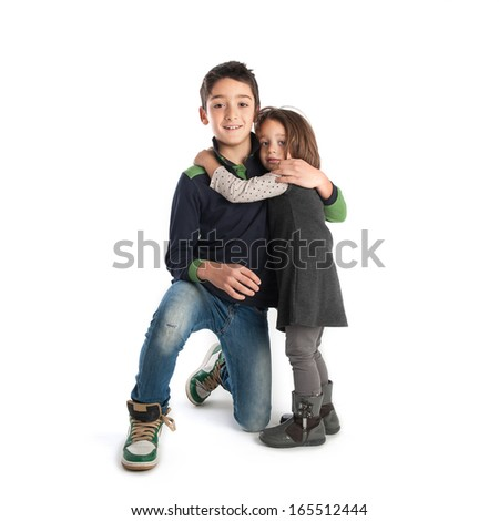 Brother and sister studio portrait.  - stock photo