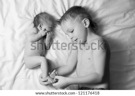 Brother and sister. Toddler daughter and son. BW Image - stock photo