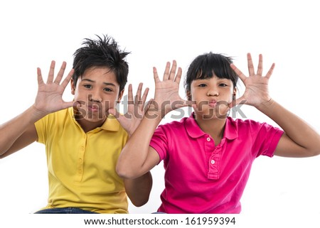 brother and sister together showing her hand up, - stock photo