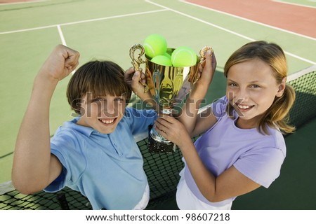 Brother and Sister with Tennis Trophy - stock photo