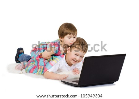 brother and the sister look cartoon films on a laptop - stock photo