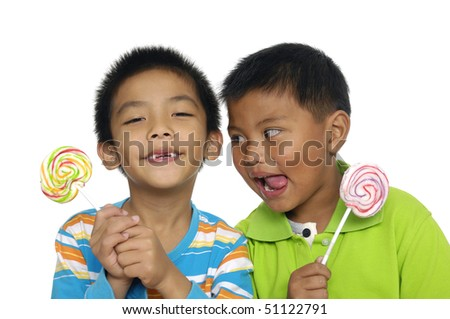 Brother holding candy on white - stock photo