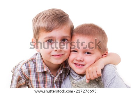 brother hugging her brother on a white background