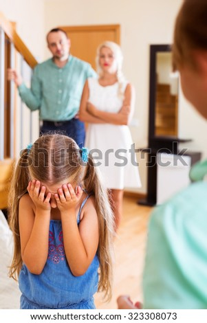 Brother is talking to her sister crying in presence of parents